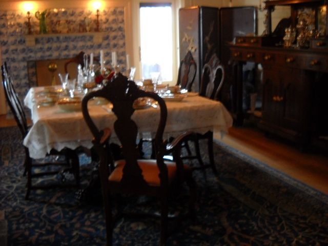 The Dining Room- Each of the tiles around the fireplace at the rear of the room was hand-painted and depicts a different scene.