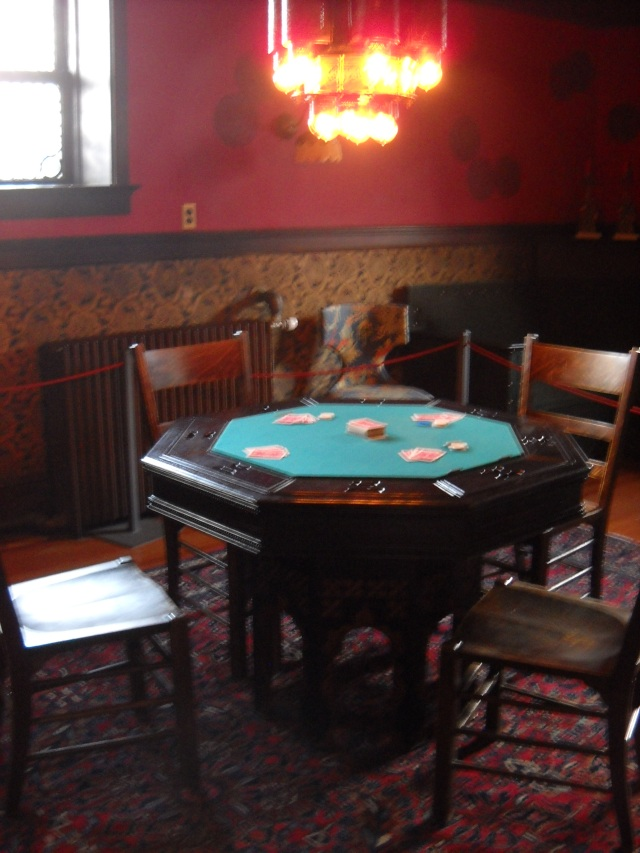 "A poker table in Mr. Campbell's ""man cave.""  Mrs. Campbell was a temperance woman, so she did not allow alcohol in the house.  This room was the only one where she allowed her husband, or anyone, to smoke and drink."