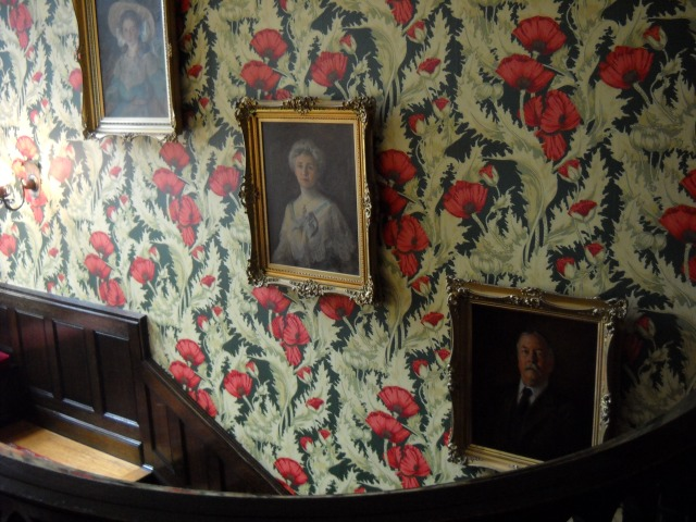 From the top of the grand staircase, one could see (from left to right) the portraits of Helen Campbell, Mrs. Grace Campbell, and Mr. Amasa Campbell.  The poppy wallpaper was a replication of the original.  The original wallpaper was adorned with specs of mica, giving it a gorgeous gold sparkle.